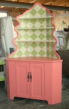 Sydney Barton - Painted Furniture A more contemporary twist to a country style corner hutch. I switched out the hardware after the picture to a pair of smaller fleur di lis knobs.