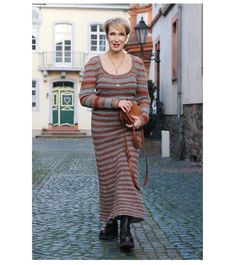 Striped maxi dress and boots | Photo shared by Claudia | For more style inspiration visit 40plusstyle.com