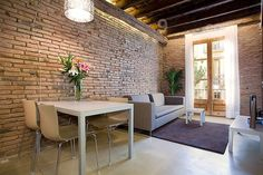 Rustic-chic style flat in Barcelona's area of Ribeira. Enjoy your stay in this flat with charming open spaces, old woodbeams, designer lights, airconditioning, wireless internet and a marble bathroom! (oh, and a small balcony). Sleeps 3 people for €125/night