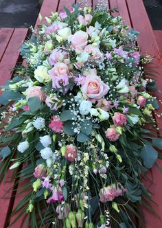 Delicate pinks casket spray by Gail Armytage florist