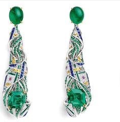 "CHAUMET est une fête collection - A reinterpretation of the Scottish tartan motif, the ""Pastorale Anglaise"" set takes inspiration from the Glyndebourne Festival with a fanciful twist.. •""Pastorale Anglaise"" Earrings in white Gold, yellow Gold and Lacquer, set with 2 emerald-cut Vivid Green Emeralds of 3.44 and 3.25 carats from Colombia Muzo, 2 cabochon-cut Emeralds of 2.68 carats each from Zambia, round Rubies, Emeralds, baguette-cut Sapphires and yellow Sapphires, and brilliant-cut…"
