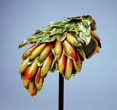 A Bes Ben close fitting velvet and net headpiece adorned with papier-mache [paper mache] yellow bananas and green leaves with gold leaf embellishment, labeled Bes Ben, Made in Chicago. 1940's.