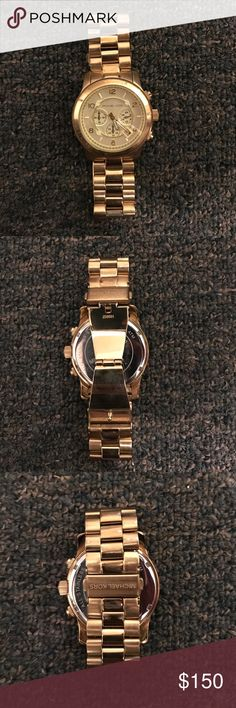 Michael Kors watch-box included Gold, large Runway. I love this watch, I just never wear it anymore. Needs a battery, and has a few scratches. Michael Kors Accessories Watches