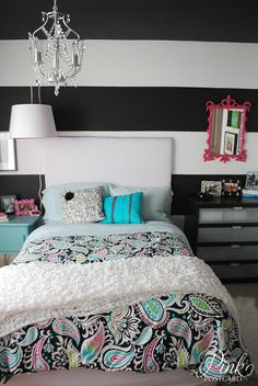 Bold black and white stripe wall in teen girl bedroom.