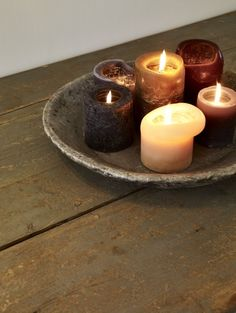 Grouping of candles in aged wooden bowl. ♥