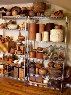 "love.  twine, all the ""things"" ~ interesting contrast between metal shelves and earthy colored items."