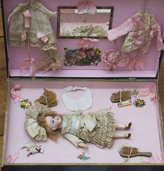 Antique German All Original Tiny Doll in presentation box w/trousseau from respectfulbear on Ruby Lane