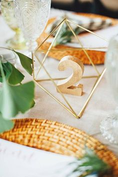 skip the cage - perfect table numbers! -- 15 Minimalist Metallic Wedding Details for the Modern Couple via Brit + Co Gold Table Numbers, Wedding Table Numbers, Wooden Numbers, Diy Wedding Decorations, Wedding Centerpieces, Wedding Trends, Trendy Wedding, Wedding Blog, Wedding Ideas