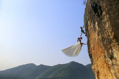 Zheng Feng, an amateur climber has his wedding pictures taken with his bride on a cliff in Jinhua, Zhejiang province, China, Oct. 26, 2014.