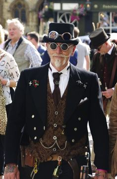 Dapper Steampunk Gentleman (men's steampunk clothing) - For costume tutorials, clothing guide, fashion inspiration photo gallery, calendar of Steampunk events, & more, visit SteampunkFashionGuide.com