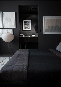 Dark bedroom with art.