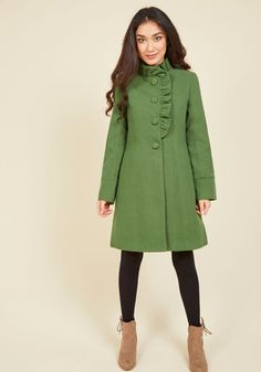 What better way to celebrate the arrival of chilly days than in the majesty of this green coat from Canadian brand Pink Martini? The big round buttons, high ruffled neckline, and feminine silhouette of this vintage-inspired garment are the perfect complement to a frolic through the flurries!