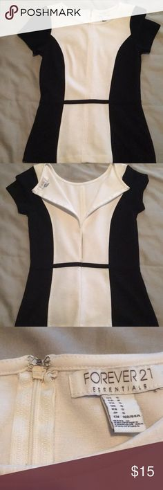Long Lined Work Top Perfect long lines match black and white at a thin waist before a small flare out to hips. Back zipper closure meets a working hook and eye clasp. Worn just to work at the office, but would transform into a cute night out too as well! Forever 21 Tops Blouses