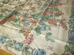 Estimated era is 1970s. The scarf has hand-rolled hems. Cream / ivory background with a lovely blue rose and grapevine print. Good condition with a minor run or two and few small faint spots as shown in second last photo. | eBay!