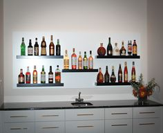 Custom Home Bar in Family Room with Floating Shelves by David Ramsay Cabinetmakers, Inc. Visit us at our website at www.ramsaycabinetmakers.com