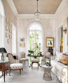 Designer Couple Takes Home To Palatial Level. THE SUNROOM: Plates on the solarium wall are from an original collection of 16,000 pieces from 1820, part of a Russian dowry. Dove-and-ecru plaid fabric by Marvic covers antique French furniture. The birch tree-print wallpaper was found in a shop called the Paint Bucket in Wisconsin.