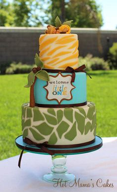 """Green, Turquoise & Yellow Leaves and Zebra Stripes for Lion King Inspired Baby Shower Cake with Sleeping Baby """"Lion"""" Topper"""