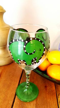 Check out this item in my Etsy shop https://www.etsy.com/listing/254405943/green-elephant-painted-red-wine-glass