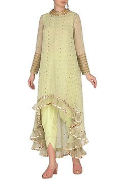 Featuring a sap green asymmetrical kurta n georgette base with sequins cheetah hand embroidery, frills and mirror border. It is paired with matching dhoti pants and inner in crepe base.