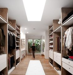***master closets orchid hill- skylight, window, full height storage, hanging and drawers on each vertical bay