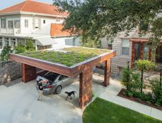 This flat-roof style is perfectly suited for a garden space on top, for added greenery. City Park Carport, New Orleans: modern Garage/shed by StudioWTA Carport Designs, Garage Design, Roof Design, Garage Renovation, Garage Interior, Garages, Carport Garage, Garage Gate, Carports