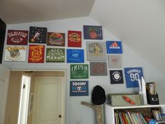 Staple shirts to a canvas!  Awesome idea for concert shirts, sports or whatever!