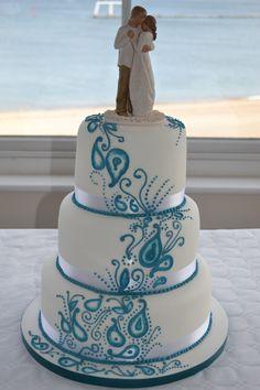 Blue paisley wedding cake www.azombiestolemycupcake.co.uk