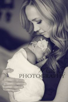 Such a stunning photo of newborn and new mom :).