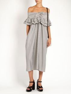 Off-the-shoulder striped midi dress   ISA ARFEN Isa Arfen's dress encapsulates two of this season's biggest trends with a shoulder-baring silhouette and two-tiered ruffled top. It's cut from black and white striped cotton and silk-blend, and falls to expose the narrowest part of the leg. Wear it with both heels and flats.