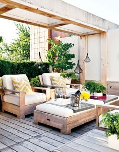 Fun and unique rooftop with white and wooden furniture and garden