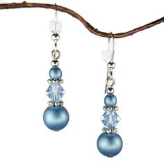Beautiful earrings made with blue glass beads along with sparking blue Swarovski crystal bicone beads separated by pewter spacers. The earrings are hung on .925 sterling silver french hook earwires. Total length from the top of the earwire is 1 9/16 inch.