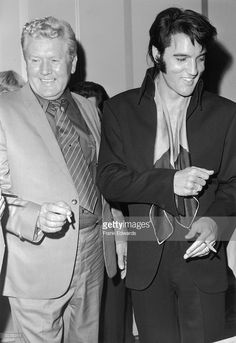 American singer and actor Elvis Presley (1935-1977) and his father, Vernon Presley (1916 - 1979),1969 Press Conference