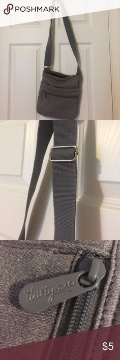 Grey Thirty One crossbody purse An everyday essential! Matches everything and has tons of pockets. Lots of room on the inside, strap is adjustable. I've used it a lot but still good condition. Bags Crossbody Bags