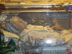 Blessed Anna Maria Taigi.  You can see her Trinitarian scapular very clearly. (Basilica of San Crisogono)