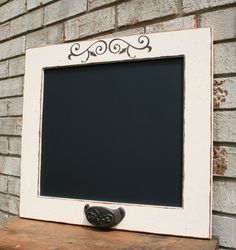 Chalkboard made on repurposed cabinet door. Make a second to put under this one with cork covered in material to match and hit cork underneath.
