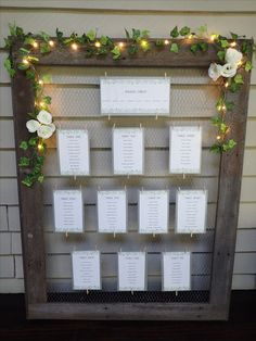 REAL WEDDING: SIMPLE, ELEGENT, RUSTIC Hand crafted wedding seating chart with chicken wire and LED lights and ivy garland
