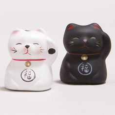 One of my favorite discoveries at WorldMarket.com: Lucky Cat Figurines - if they bring luck, I'll put them all over my house! LOL