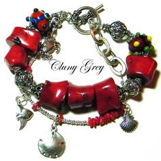 coral bracelet with sterling silver and lampwork beads - http://www.clunygreyjewelry.com/Coral-bracelets.html #coraljewelry  #coralbracelet