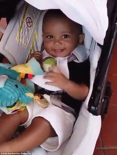 He's a natural: Kim Kardashian's son Saint stole the spotlight with his megawatt smile at his great grandma MJ's birthday bash in San Diego, CA on Tuesday