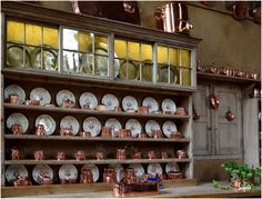 Antique country style interior kitchen with copper molds