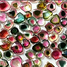 Watermelon tourmaline is a variety of concentrically color-zoned tourmaline with red interiors and green exteriors. All colored Tourmaline gems display pleochroism, meaning their color changes when viewed at different angles. Minerals And Gemstones, Rocks And Minerals, Turquoise Rose, National Watermelon Day, Watermelon Tourmaline, Tourmaline Gemstone, October Birth Stone, Stones And Crystals, Gem Stones
