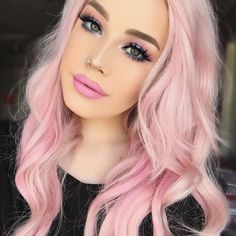 Curly pastel pink hairstyle by hailiebarber