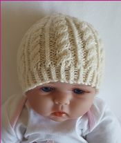 Knitting pattern for an 8ply cable beanie for baby - sizes 0 to 12 months.