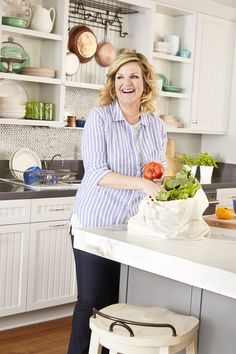 """""""I go through a grid of recipes from all three of my cookbooks to see what we've used and what we haven't on my cooking show for Food Network"""" -Trisha Yearwood cooking in her kitchen."""