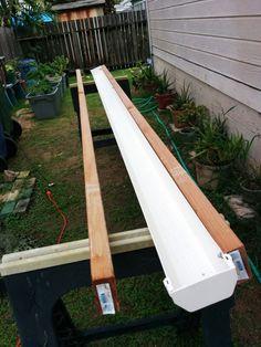 Beginnings of a self-watering rain gutter grow system (per Larry Hall, Brainerd, MN)