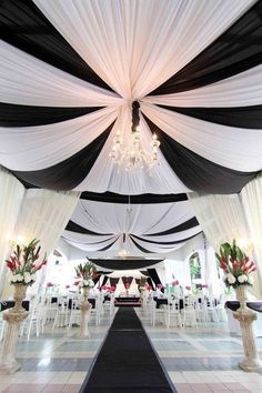 Ceiling drapes and swags wedding ceremony decor / http://www.himisspuff.com/black-and-white-sassy-stripes-wedding-ideas/5/