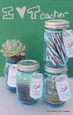 Display table accent. Fill jars with a variety of themed items making each one unique... because it's what's on the inside that counts!  (could also use seashells, pennies, spools of thread, crayons, nail polish, novelty buttons, photos, beads, old cell phones, maps, sheet music, 1st aid kit, game board pieces, etc.)
