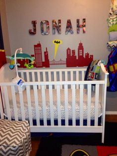 Super hero nursery decor for Jonah! (Yes there are capes and masks on the mobile animals)