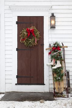 Christmas Door Decorations - gotta now find myself a sled & some old pair of skates LOL