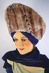 1940s Velvet Mink Hat styled with a high, mink crown, and fitted velvet sides. The velvet wrap ties at the back of the head in a turban like manner and can then be worn like a scarf around the neck or left to fall loosely in the back.